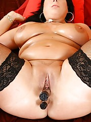 Fat brunette in fishnets fucking her pussy with a big fat toy