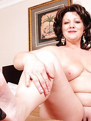 Chubby MILF with awesome eyebrows showing her feet and pussy