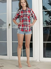 Plaid shirt denim shorts brunette taking off her white panties outdoors