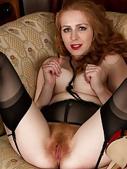 Luxurious-looking redhead showing off her fiery pussy up close