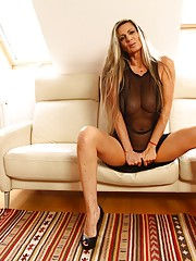 See-through get-up tanned MILF showing off her luxurious body
